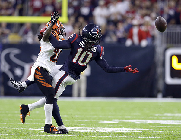 <div class='meta'><div class='origin-logo' data-origin='AP'></div><span class='caption-text' data-credit='AP Photo/Sam Craft'>Houston Texans wide receiver DeAndre Hopkins (10) reaches for a pass as Cincinnati Bengals cornerback Adam Jones (24) defends during the second half of an NFL football game.</span></div>