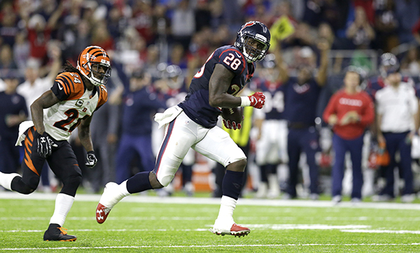 <div class='meta'><div class='origin-logo' data-origin='AP'></div><span class='caption-text' data-credit='AP Photo/Sam Craft'>Houston Texans running back Alfred Blue (28) rushes for a touchdown as Cincinnati Bengals cornerback Adam Jones (24) defends during the second half of an NFL football game.</span></div>