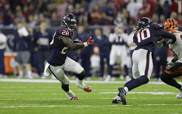 """<div class=""""meta image-caption""""><div class=""""origin-logo origin-image ap""""><span>AP</span></div><span class=""""caption-text"""">Houston Texans running back Alfred Blue (28) rushes for a touchdown against the Cincinnati Bengals during the second half of an NFL football game. (AP Photo/Sam Craft)</span></div>"""