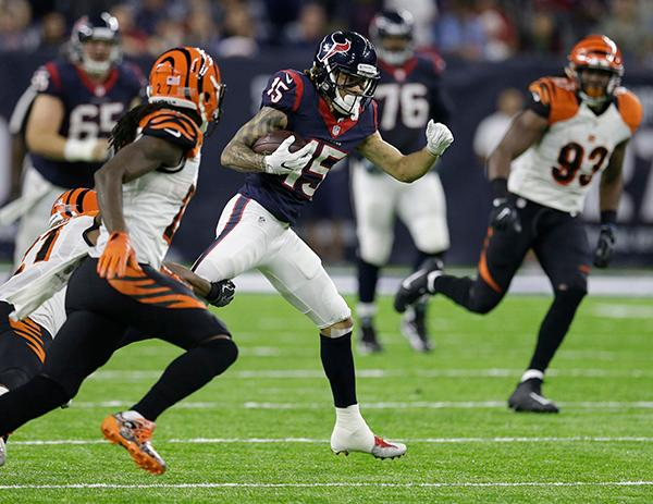 <div class='meta'><div class='origin-logo' data-origin='AP'></div><span class='caption-text' data-credit='AP Photo/Sam Craft'>Houston Texans wide receiver Will Fuller (15) catches a pass against the Cincinnati Bengals during the second half of an NFL football game Saturday, Dec. 24, 2016.</span></div>