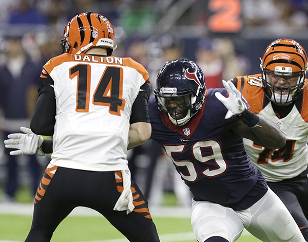 <div class='meta'><div class='origin-logo' data-origin='AP'></div><span class='caption-text' data-credit='AP Photo/Sam Craft'>Cincinnati Bengals quarterback Andy Dalton (14) is sacked by Houston Texans' Whitney Mercilus (59) during the second half of an NFL football game Saturday, Dec. 24, 2016.</span></div>