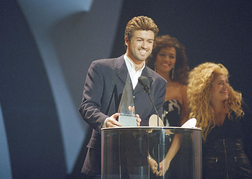 <div class='meta'><div class='origin-logo' data-origin='AP'></div><span class='caption-text' data-credit='AP Photo/Alan Greth'>Crossover singer George Michael breaks out in a big smile as he accepts one of his three American Music Awards during ceremonies Monday night, Jan. 31, 1989.</span></div>