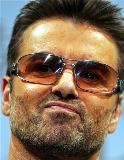 <div class='meta'><div class='origin-logo' data-origin='AP'></div><span class='caption-text' data-credit='AP Photo/Junji Kurokawa'>British singer George Michael poses for photo session prior to a press conference to promote his documentary film &#34;George Michael, A differenct story,&#34; in 2005.</span></div>