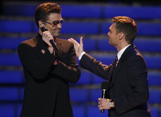 <div class='meta'><div class='origin-logo' data-origin='AP'></div><span class='caption-text' data-credit='AP Images for Fox'>George Michael, left, is seen on stage with Ryan Seacrest at the season finale of American Idol on Wednesday May 21, 2008, in Los Angeles.</span></div>