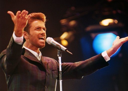 <div class='meta'><div class='origin-logo' data-origin='AP'></div><span class='caption-text' data-credit='AP Photo/Gill Allen'>British singer George Michael performs in front of an audience of 11,000 people including Diana, the Princess of Wales to mark World AIDS Day on December 2, 1993.</span></div>