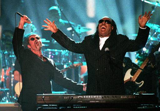 <div class='meta'><div class='origin-logo' data-origin='AP'></div><span class='caption-text' data-credit='AP Photo/Mark J. Terrill'>George Michael, left, and Stevie Wonder perform &#34;Living for the City&#34; at the &#34;4th annual VH1 Honors&#34; Thursday night, April 10, 1997, in Universal City, Calif.</span></div>