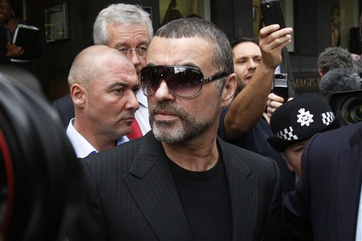 <div class='meta'><div class='origin-logo' data-origin='AP'></div><span class='caption-text' data-credit='ASSOCIATED PRESS'>British singer George Michael leaves Highbury Corner Magistrates Court in north London, Tuesday, Aug. 24, 2010.</span></div>