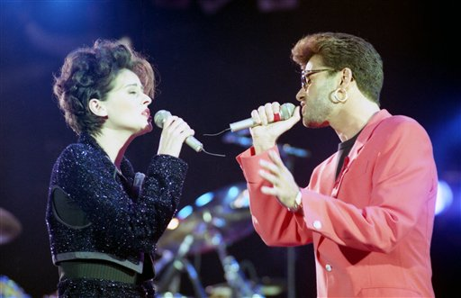 <div class='meta'><div class='origin-logo' data-origin='AP'></div><span class='caption-text' data-credit='AP Photo/Gill Allen'>British singers George Michael, right, and Lisa Stansfield perform together on stage at the Freddie Mercury Tribute Concert at Wembley Arena, United Kingdom, on April 20, 1992.</span></div>