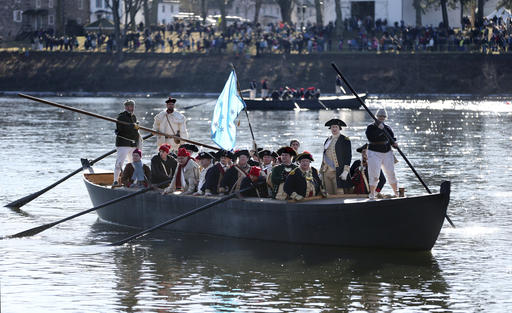 <div class='meta'><div class='origin-logo' data-origin='AP'></div><span class='caption-text' data-credit='AP Photo/Mel Evans'>John Godzieba as Gen. George Washington, second right, stands in a boat during a re-enactment of Washington's daring Christmas 1776 crossing of the Delaware River.</span></div>