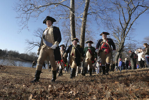 <div class='meta'><div class='origin-logo' data-origin='AP'></div><span class='caption-text' data-credit='AP Photo/Mel Evans'>John Godzieba, left, as Gen. George Washington, marches with his men in New Jersey after crossing the Delaware River.</span></div>