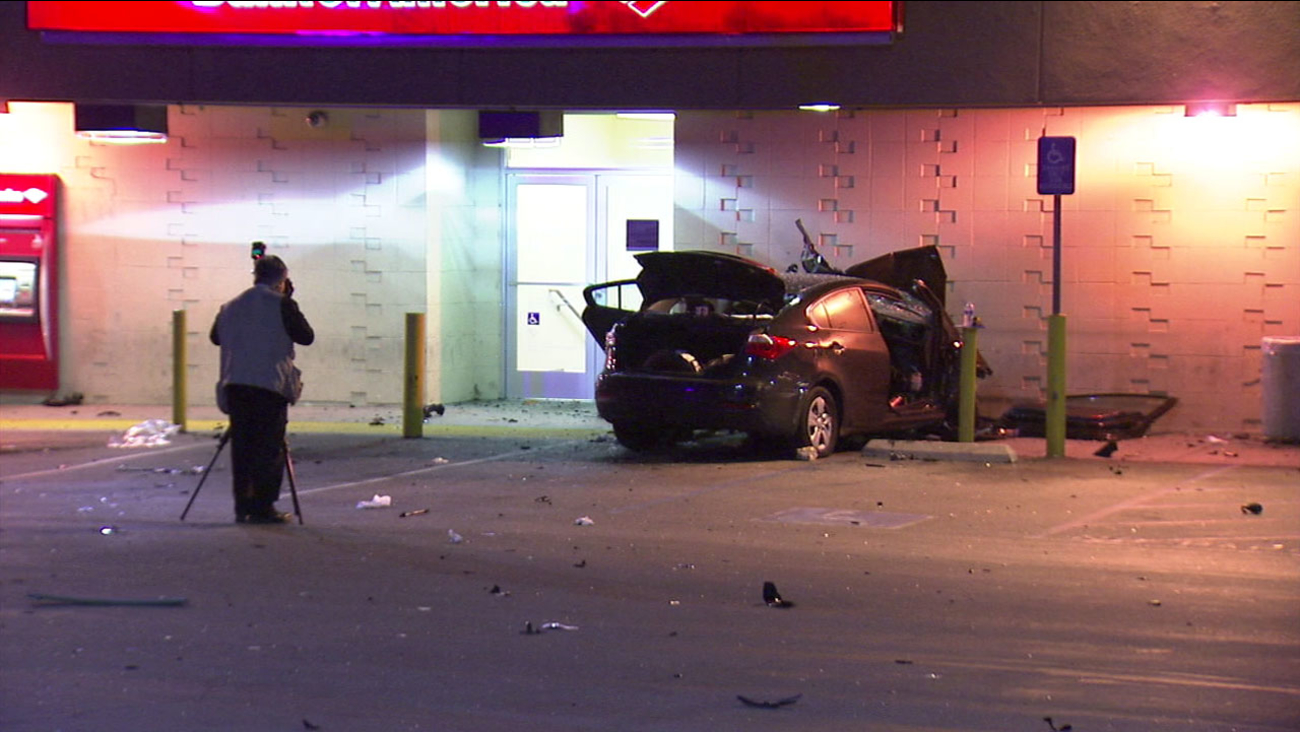 Authorities investigate the scene of a deadly car crash that happened on Christmas Day 2016 in Mid-City.