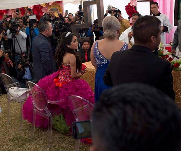 <div class='meta'><div class='origin-logo' data-origin='AP'></div><span class='caption-text' data-credit='AP'>Thousands attend girl's quinceañera in Mexico</span></div>