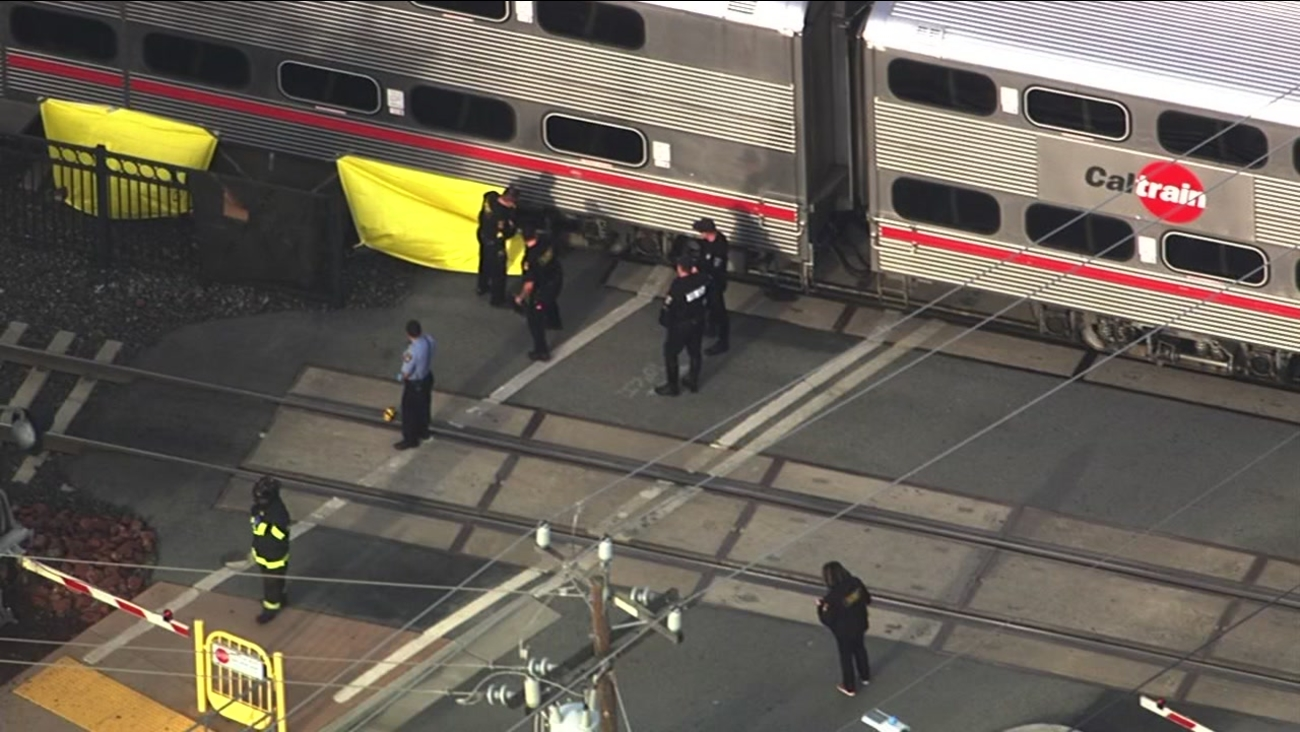Emergency crews are seen responding after a man was fatally struck by Caltrain in Burlingame, Calif. on Tuesday, December 27, 2016.