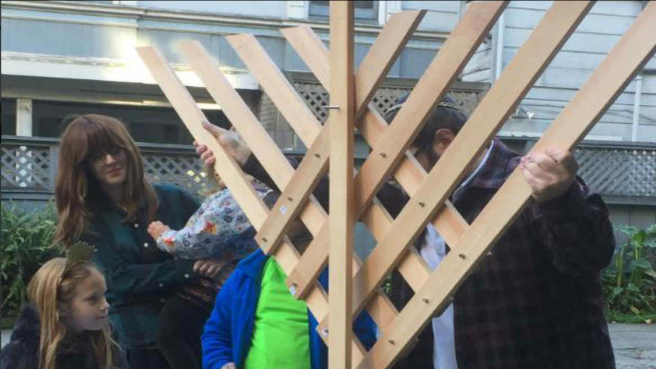 San Francisco residents construct a menorah after one was stolen from their North Beach neighborhood on Wednesday, Dec. 28 2016.