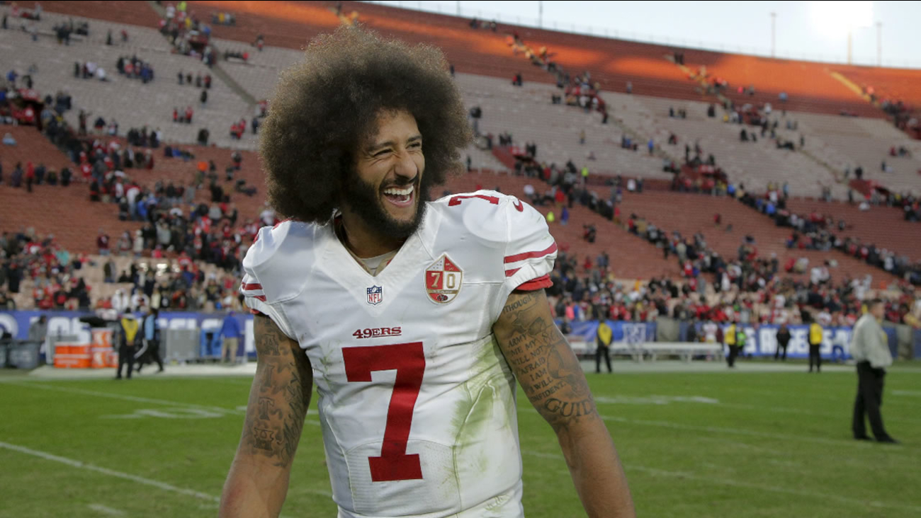 Colin Kaepernick smiles after the 49ers' 22-21 win over the Los Angeles Rams during an NFL football game Saturday, Dec. 24, 2016, in Los Angeles.