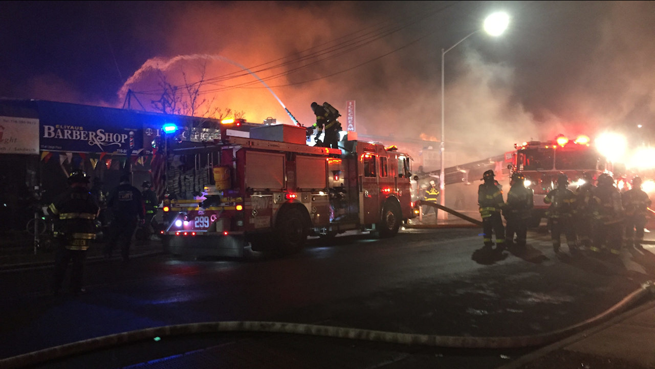 5 Alarm Fire Tears Through Row Of N Y Stores 3 Firefighters Hurt