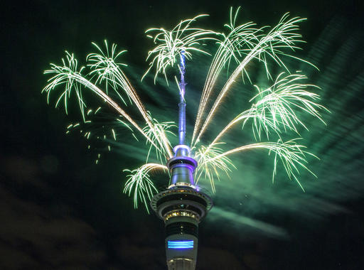 <div class='meta'><div class='origin-logo' data-origin='AP'></div><span class='caption-text' data-credit='Peter Meecham/New Zealand Herald via AP'>Fireworks explode off Auckland's Sky Tower as the new year is welcomed to New Zealand, Jan 1, 2017.</span></div>