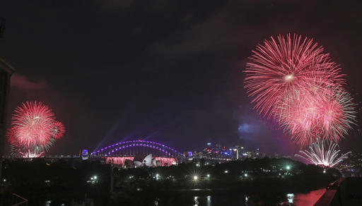<div class='meta'><div class='origin-logo' data-origin='AP'></div><span class='caption-text' data-credit='AP Photo/Rick Rycroft)'>House and Harbour Bridge as New Year's celebrations get underway in Sydney, Australia, Saturday, Dec. 31, 2016.</span></div>