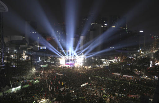 <div class='meta'><div class='origin-logo' data-origin='AP'></div><span class='caption-text' data-credit='AP Photo/Lee Jin-man'>People attend Seoul's traditional bell-tolling ceremony for the new year, at the Bosingak pavilion in Seoul, South Korea, early Sunday, Jan. 1, 2017.</span></div>