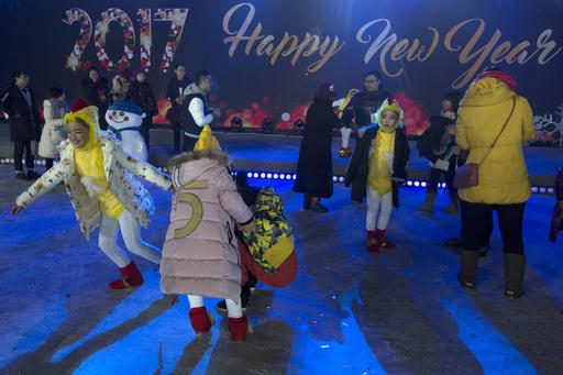 <div class='meta'><div class='origin-logo' data-origin='AP'></div><span class='caption-text' data-credit='AP Photo/Ng Han Guan'>Performers enjoy themselves after a countdown to the New Year event in Beijing, China, Sunday, Jan. 1, 2017.</span></div>