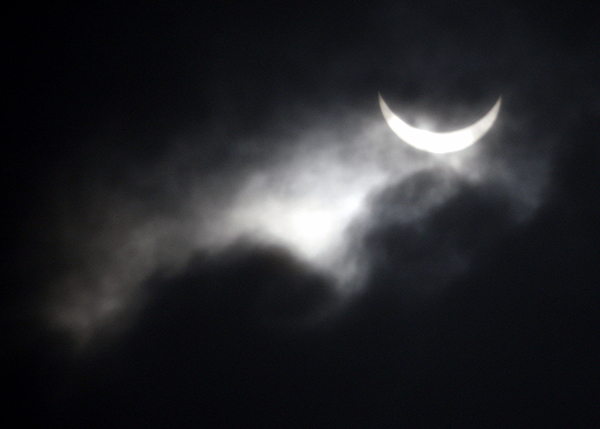 <div class='meta'><div class='origin-logo' data-origin='AP'></div><span class='caption-text' data-credit='AP Photo/Eugene Hoshiko'>A partial solar eclipse is seen among heavy cloud in Yanguan town, Haining City, China, Wednesday, July 22, 2009.</span></div>