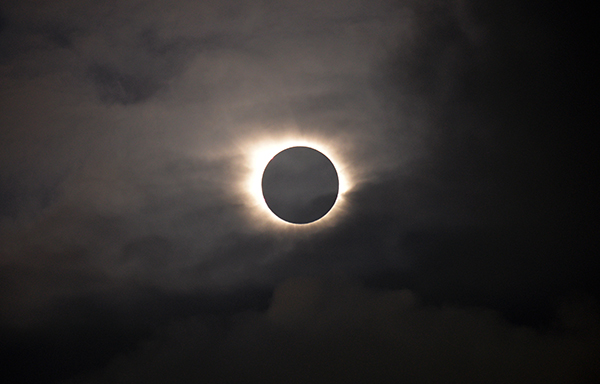<div class='meta'><div class='origin-logo' data-origin='AP'></div><span class='caption-text' data-credit='AP Photo/Eric Adams'>A total solar eclipse is visible through the clouds as seen from Vagar on the Faeroe Islands, Friday, March 20, 2015.</span></div>