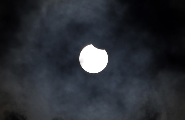 <div class='meta'><div class='origin-logo' data-origin='AP'></div><span class='caption-text' data-credit='AP Photo/Khalil Hamra'>The moon and the sun overlap in a partial solar eclipse above the Gaza Strip, Friday, March, 20, 2015. The partial eclipse was visible across Europe and parts of Asia and Africa.</span></div>