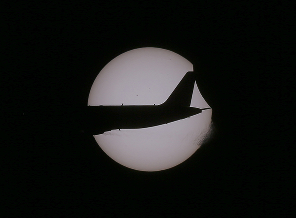 <div class='meta'><div class='origin-logo' data-origin='AP'></div><span class='caption-text' data-credit='AP Photo/Bullit Marquez'>An Air Asia passenger plane flies as a partial solar eclipse occurs Wednesday, March 9, 2016 as seen from Taguig city, east of Manila, Philippines.</span></div>