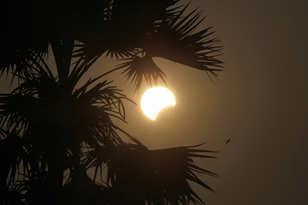 <div class='meta'><div class='origin-logo' data-origin='AP'></div><span class='caption-text' data-credit='AP Photo/Aung Shine Oo'>A partial solar eclipse is seen behind a palm tree in Naypyitaw, Myanmar, Wednesday, March 9, 2016.</span></div>
