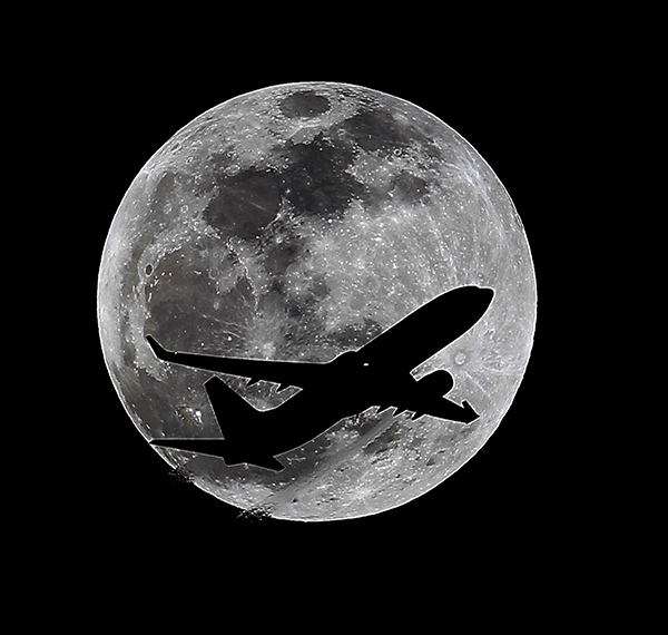 <div class='meta'><div class='origin-logo' data-origin='AP'></div><span class='caption-text' data-credit='AP Photo/Nick Ut'>An airliner crosses the moon's path, Monday, April 14, 2014, above Whittier, Calif., approximately one hour before a total lunar eclipse.</span></div>