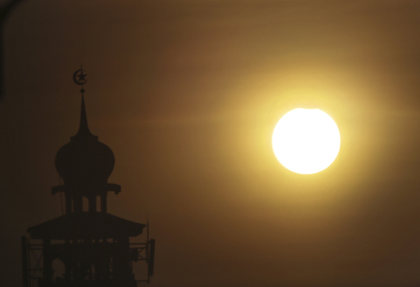 <div class='meta'><div class='origin-logo' data-origin='AP'></div><span class='caption-text' data-credit='AP Photo/Achmad Ibrahim'>A partial solar eclipse is seen in Jakarta, Indonesia, Wednesday, March 9, 2016.</span></div>
