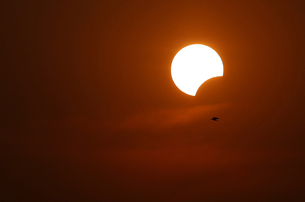 <div class='meta'><div class='origin-logo' data-origin='AP'></div><span class='caption-text' data-credit='AP Photo/A.M. Ahad'>A partial solar eclipse is seen as a bird flies past in Dhaka, Bangladesh, Wednesday, March 9, 2016.</span></div>