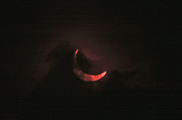 <div class='meta'><div class='origin-logo' data-origin='AP'></div><span class='caption-text' data-credit='AP Photo/Sayyid Azim'>A cloud layer partially obstructs a view of a the moon passing in front of the sun in this partial solar eclipse, Sunday, Nov. 3, 2013 in Nairobi, Kenya.</span></div>