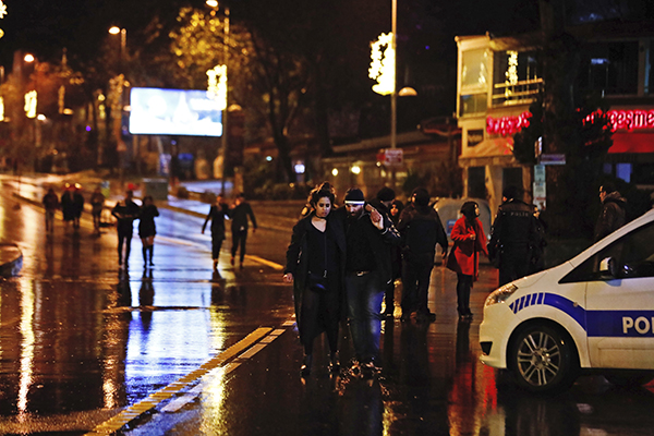 <div class='meta'><div class='origin-logo' data-origin='AP'></div><span class='caption-text' data-credit='AP Photo/Halit Onur Sandal'>Young people leave from the scene of an attack in Istanbul, early Sunday, Jan. 1, 2017.</span></div>