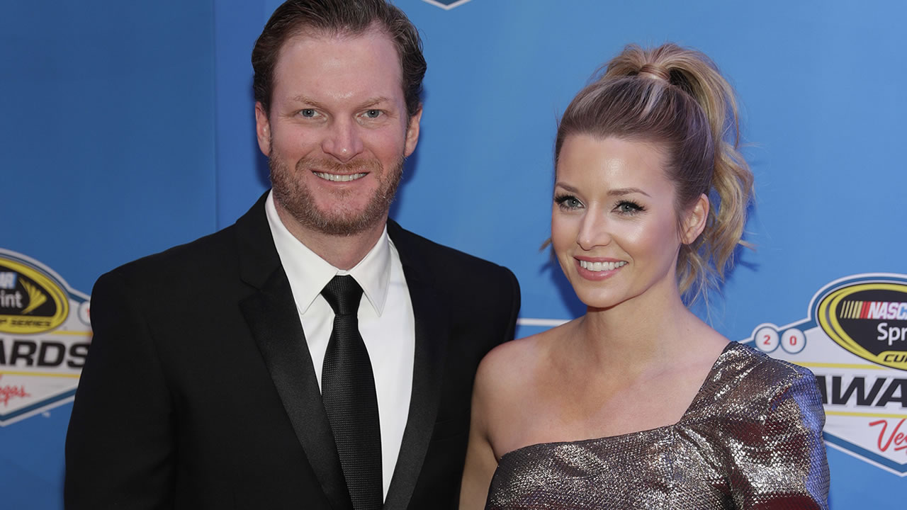 Dale Earnhardt Jr. and Amy Reimann pose on the red carpet during the NASCAR Sprint Cup Series auto racing awards Friday, Dec. 2, 2016, in Las Vegas. (AP Photo/John Locher)
