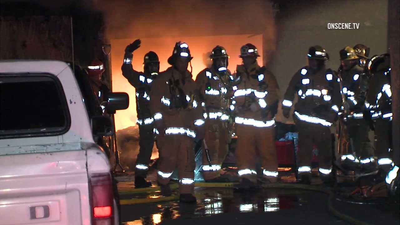 Los Angeles County firefighters at the scene of a fire in Willowbrook early Monday, Jan. 2, 2017.