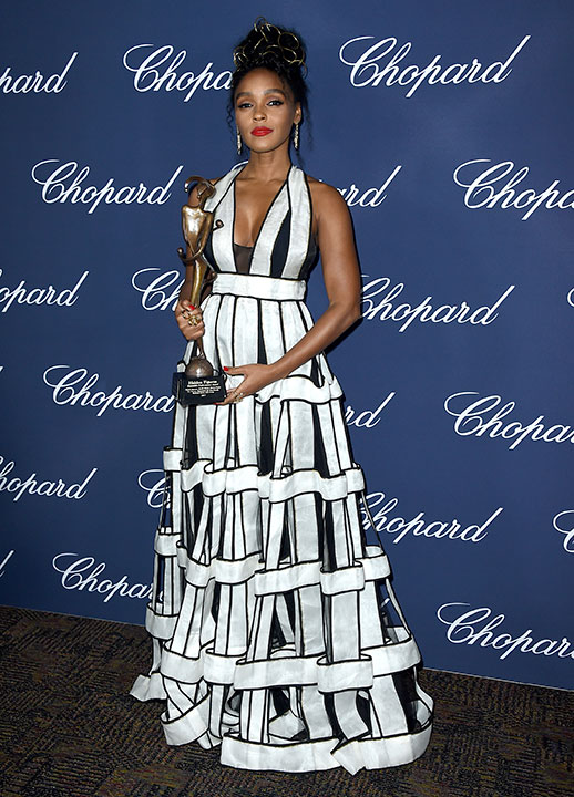 "<div class=""meta image-caption""><div class=""origin-logo origin-image none""><span>none</span></div><span class=""caption-text"">Janelle Monae poses backstage with the ensemble performance award for ''Hidden Figures'' at the 28th annual Palm Springs International Film Festival Awards Gala. (Jordan Strauss/Invision/AP)</span></div>"