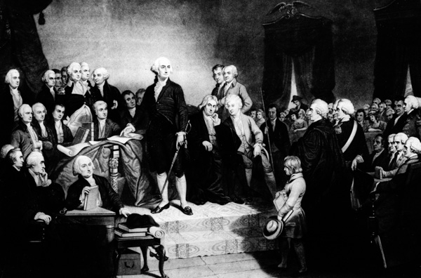 <div class='meta'><div class='origin-logo' data-origin='AP'></div><span class='caption-text' data-credit='AP Photo'>President George Washington delivers his inaugural address in the Senate Chamber of Old Federal Hall in New York on April 30, 1789.</span></div>