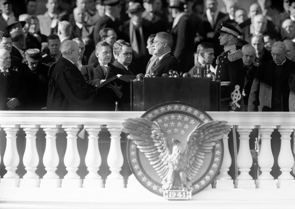 <div class='meta'><div class='origin-logo' data-origin='AP'></div><span class='caption-text' data-credit='AP Photo'>President Franklin D. Roosevelt takes his third term oath of office at the Capitol in Washington, Jan. 20, 1941.</span></div>