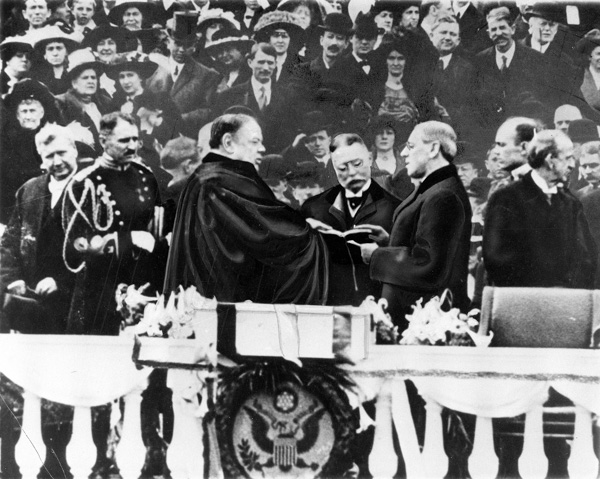 <div class='meta'><div class='origin-logo' data-origin='AP'></div><span class='caption-text' data-credit='AP Photo'>Woodrow Wilson takes the oath of office for his first term of the Presidency on the East Portico at the U.S. Capitol in Washington, D.C., on March 4, 1913.</span></div>