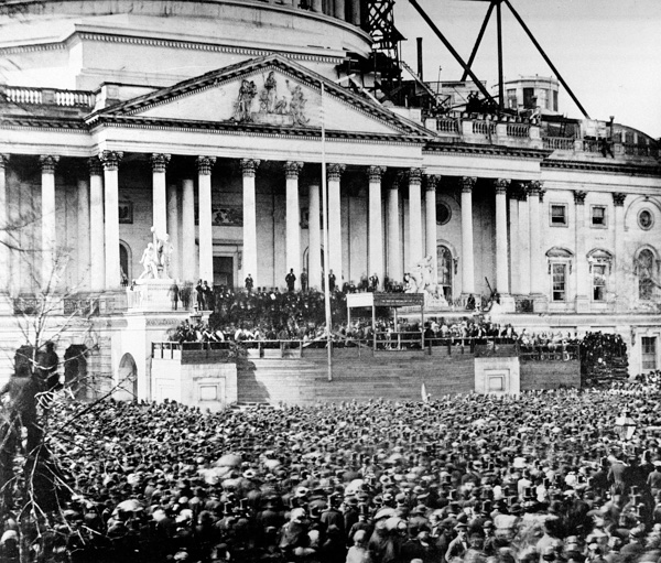 <div class='meta'><div class='origin-logo' data-origin='AP'></div><span class='caption-text' data-credit='AP Photo'>U.S. President Abraham Lincoln stands under cover at center of Capitol steps during his inauguration in Washington, D.C., on March 4, 1861.</span></div>