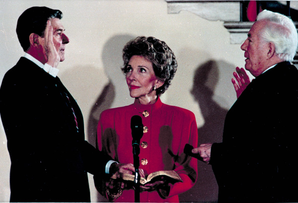 <div class='meta'><div class='origin-logo' data-origin='none'></div><span class='caption-text' data-credit='Ira Schwarz/AP Photo'>President Ronald Reagan takes the oath of office administered by Chief Justice Warren Burger in a private White House ceremony for a second term in Washington, D.C., Jan. 20, 1985.</span></div>