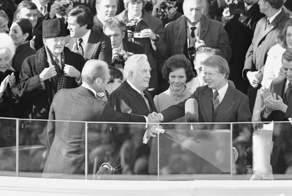 <div class='meta'><div class='origin-logo' data-origin='none'></div><span class='caption-text' data-credit='AP Photo'>Outgoing President Gerald Ford reaches to shake hands with President Jimmy Carter at the Capitol in Washington on Thursday, Jan. 20, 1977 after Carter took the oath of office.</span></div>