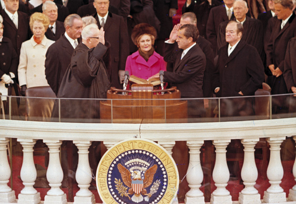 <div class='meta'><div class='origin-logo' data-origin='none'></div><span class='caption-text' data-credit='AP Photo'>Richard M. Nixon, is sworn in as President of the United States administered by Chief Justice Earl Warren, left, during inaugural ceremonies in in Washington, D.C., Jan. 20, 1969.</span></div>