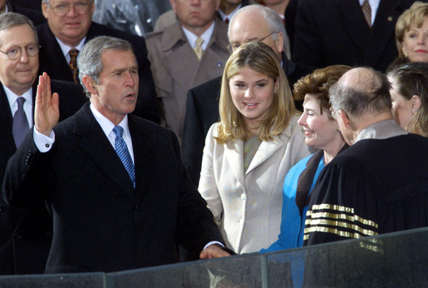 <div class='meta'><div class='origin-logo' data-origin='none'></div><span class='caption-text' data-credit='Doug Mills/AP Phto'>George W. Bush takes the oath of office from Chief Justice William Rehnquist to become the 43rd president Saturday, Jan. 20, 2001, in Washington.</span></div>
