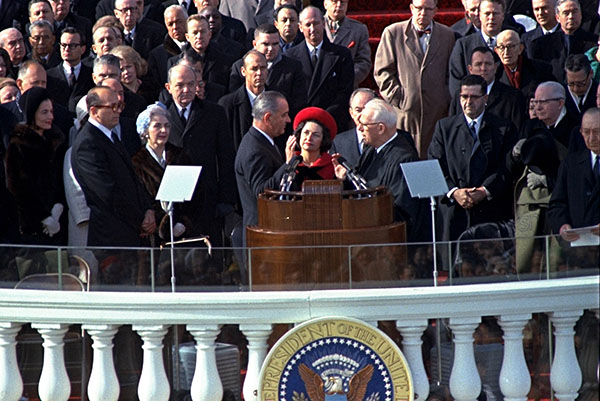 <div class='meta'><div class='origin-logo' data-origin='none'></div><span class='caption-text' data-credit='AP Photo'>Lyndon Johnson takes the oath of office, during the inauguration ceremonies in front of the Capitol Building in Washington, D.C., on Jan. 20, 1965.</span></div>