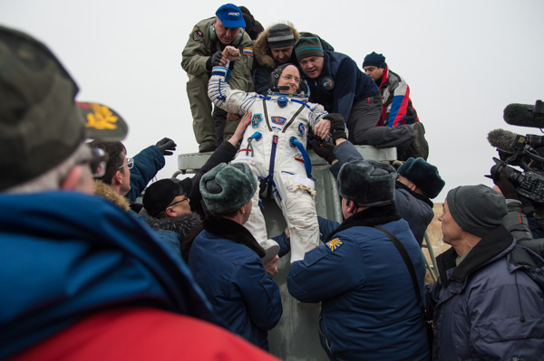 "<div class=""meta image-caption""><div class=""origin-logo origin-image none""><span>none</span></div><span class=""caption-text"">Expedition 46 Commander Scott Kelly is helped out the Soyuz TMA-18M spacecraft after he and Russian cosmonaut Mikhail Kornienko completed an ISS record year-long mission (NASA/Bill Ingalls)</span></div>"