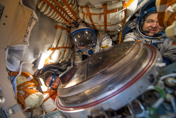 "<div class=""meta image-caption""><div class=""origin-logo origin-image none""><span>none</span></div><span class=""caption-text"">NASA astronaut Jeff Williams, Russian cosmonaut Alexey Ovchinin of Roscosmos and Russian cosmonaut Oleg Skripochka of Roscosmos are seen inside the Soyuz TMA-20M spacecraft. (NASA/Bill Ingalls)</span></div>"