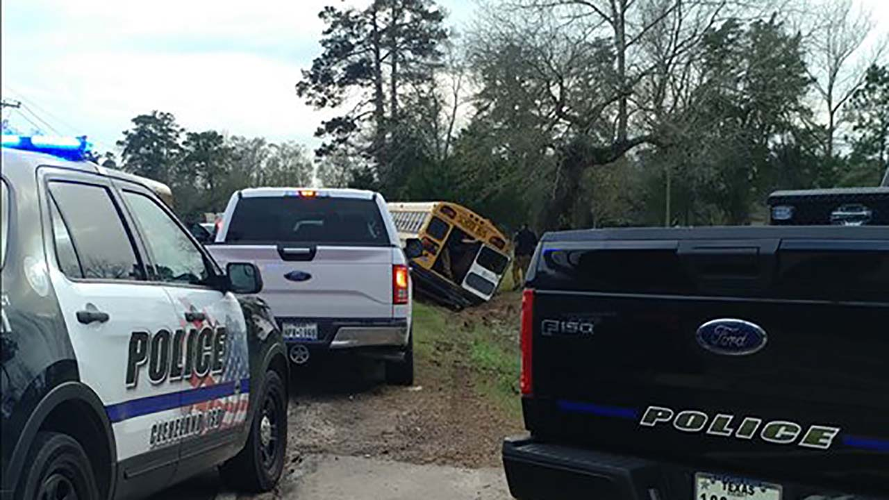 65 students taken to hospital after bus flipped over in