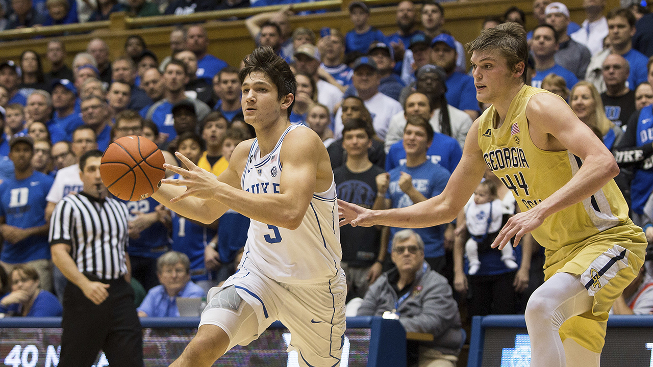 Duke's Grayson Allen, returning from a one-game suspension, drives against Georgia Tech's Ben Lammers on Wednesday night.